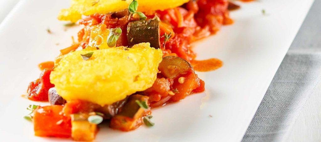 Stockfisch in Ausbackteig mit tomaten