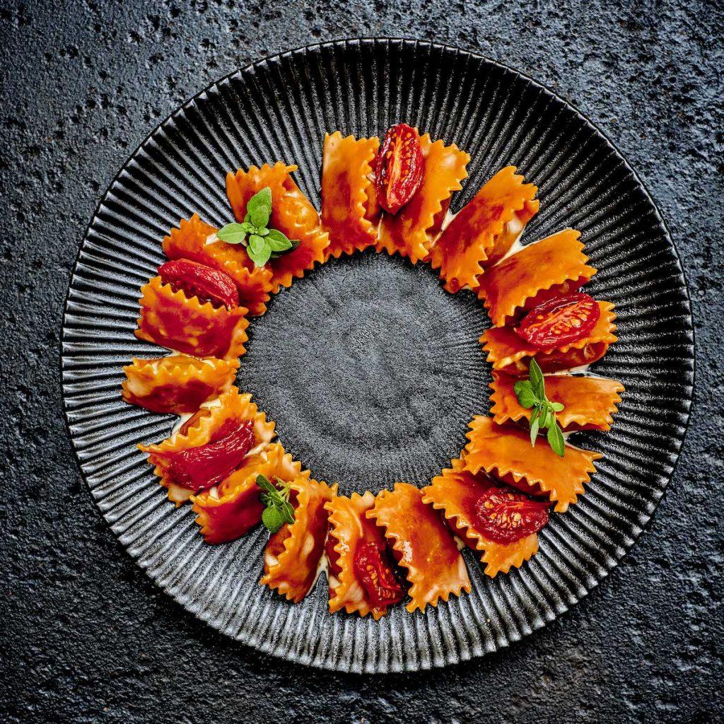 Raviolis del plin au confit de tomate