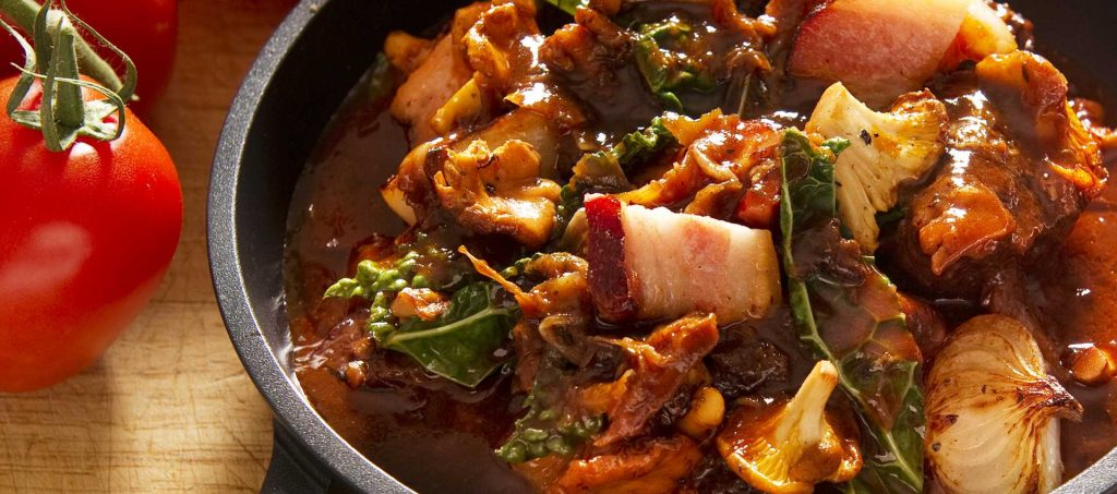 Autumn casserole with bacon, black kale and chanterelles