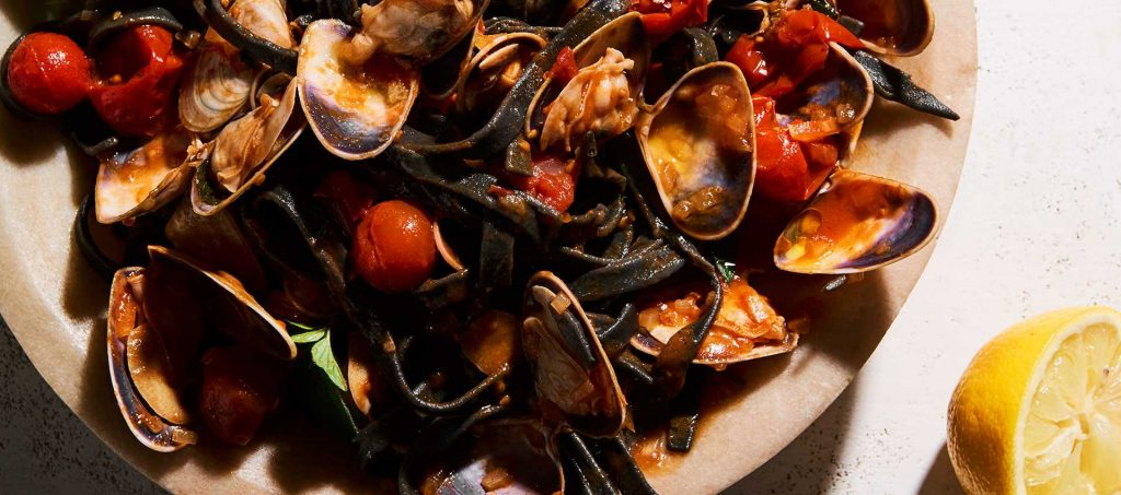 Pipis with Mutti Cherry Tomatoes and Squid Ink Fettuccini