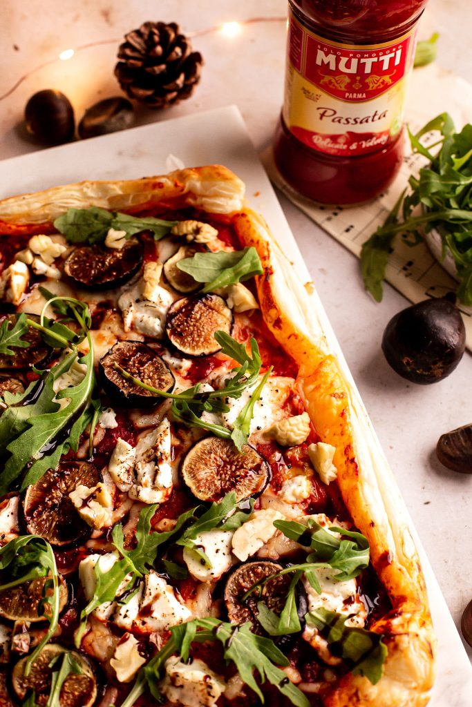 Tomato puff pastry tart with ricotta, figs, balsamic glaze, rocket leaves and roasted chestnuts