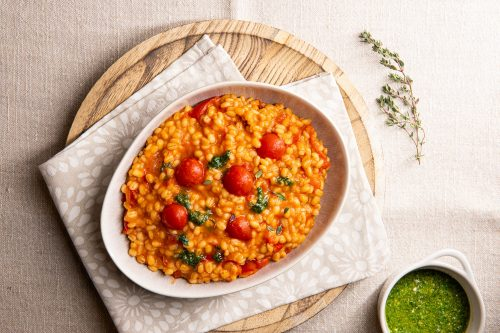 Pearl barley risotto with cherry tomatoes, light basil pesto, thyme and toasted pine nuts