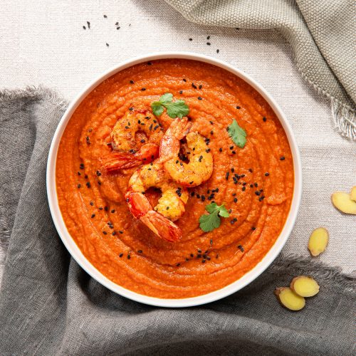 Tomato vellutata with ginger and prawns