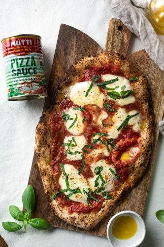 Grilled Flatbread Tomato Mozzarella Pizza with fresh basil and extra virgin olive oil